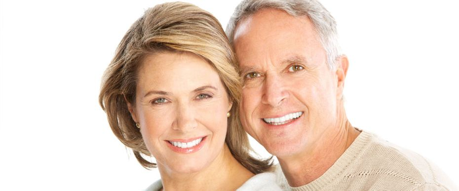 A couple that is wearing dental implants in Mississauga