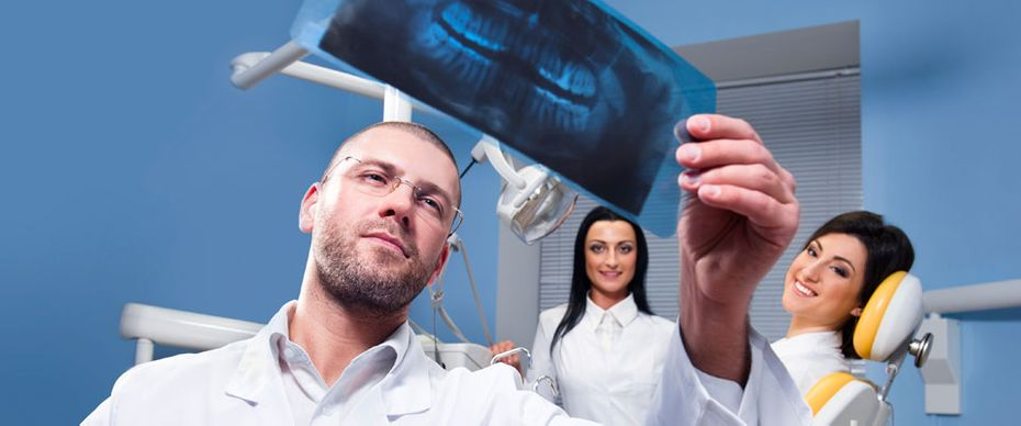 Dentist examining an X-ray in our cosmetic dentistry practice in Mississauga